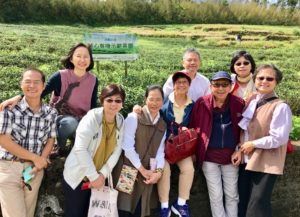 With happy volunteers from the Bliss and Wisdom Foundation at their organic tea plantation. Jack Huang is the gentleman in the white shirt at the back.