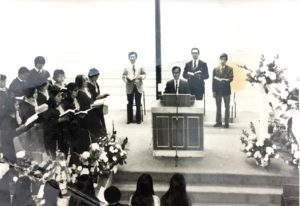 Church service inside the Gospel Church, with Rev. Ho preaching, me on the left, and Eddie Mak on the right.